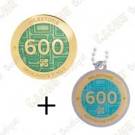 "Geocoin + Traveler ""Milestone"" - 600 Finds"